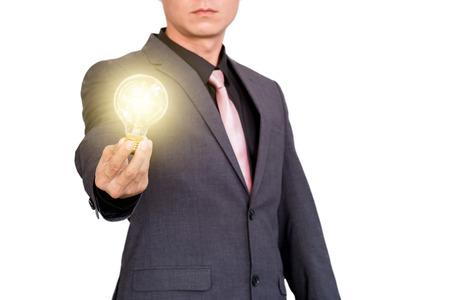 Podnikatel ukazuje kreativní obchodní strategie s žárovkou jako koncept Reklamní fotografie