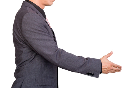 Businessman extending hand to shake.