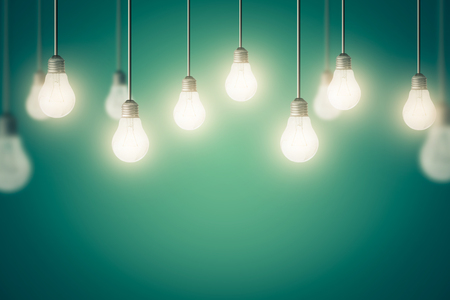 Glowing Hanging Light Bulb, business idea concept and background.