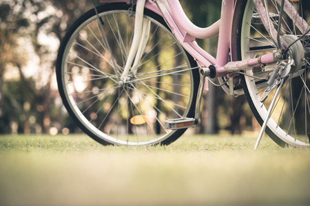 Close up of part of vintage bicycle on the grass field Reklamní fotografie
