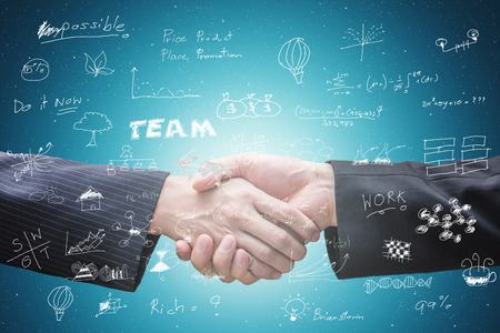 Business partner hand shake and technology background.