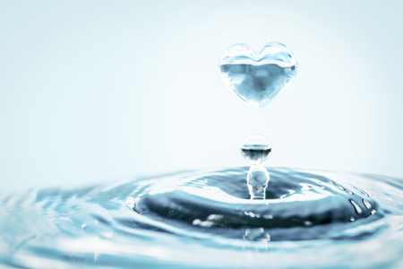 Close up of water drop falling down to the glass.