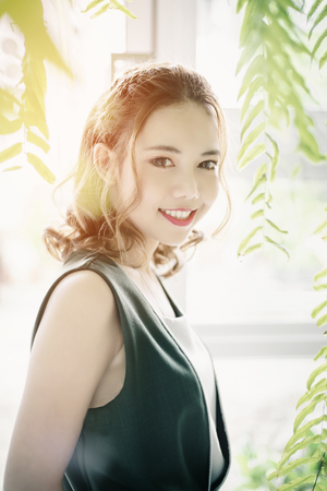 Beautiful Smiling Young Asian Woman. Portrait of cute girl with clean, fresh and perfect skin. Reklamní fotografie