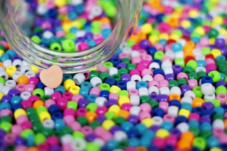 Spilled Jar of colorful beads and heart