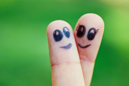 Two finger puppets smiling at one another photo