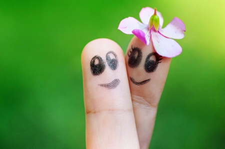 puppets: Finger Puppets Holding One Another Smiling with Flower Cap Stock Photo