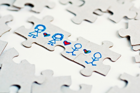 bisexual: Puzzle peices with stick figures and hearts representing all types of Love Stock Photo