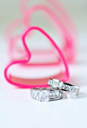 heats: Wedding Band with Cookie Cutter Heats in Background Stock Photo