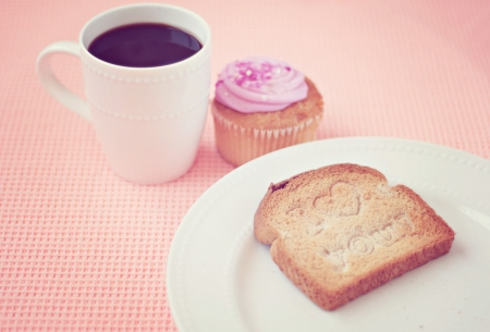 Toast that reads I love you with coffee and muffin
