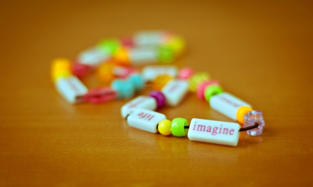 Colorful beaded necklace with word imagine