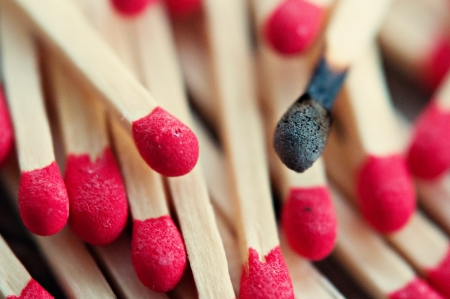 Close up of matches with one burnt