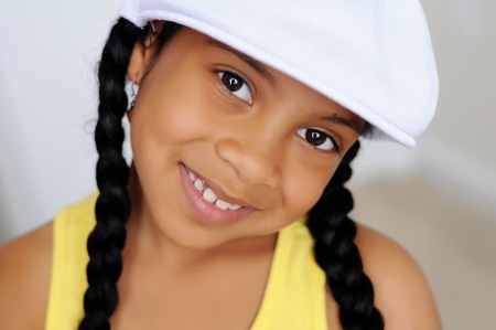 Young girl in white hat smiling photo