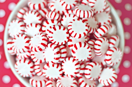 Large Bowl of Peppermints on Polka Dot Background