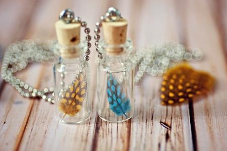 Bottled Feathers Banco de Imagens - 21423371