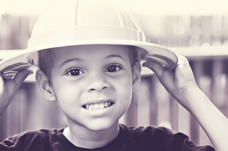 Little boy in safari hat in backyard