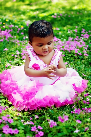 beautiful little girl in flower garden