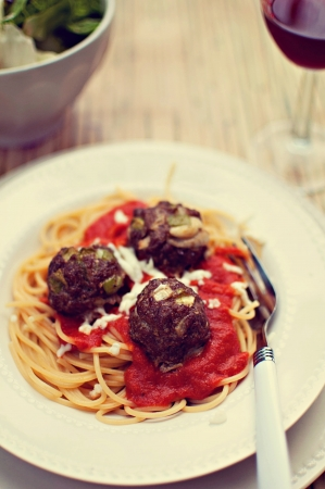 Spaghetti with meat balls, salad and wine