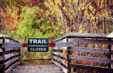 Bridge with trail temporarily closed sign