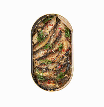 Isolated open tin of Baltic sprats in oil with spices on a white background Reklamní fotografie