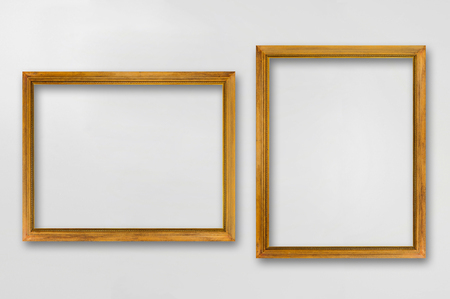antique wood: Picture frames isolated on a gray background.