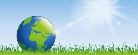planeta ziemia na zielonej łące ze słonecznym sztandarem z miejscem na kopię
