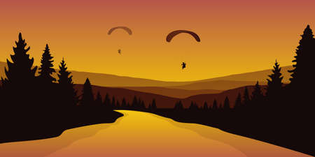 paraglider by big river in a forest autumn landscape