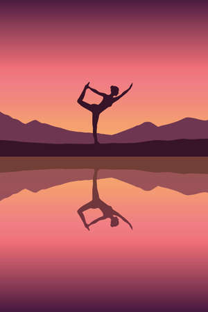 girl makes yoga by the lake at sunset
