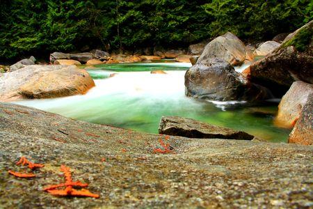 大きな岩の間を流れる川 写真素材