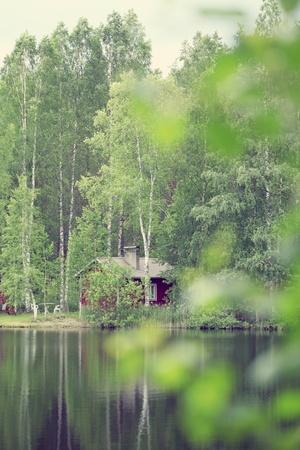 finland: summer cottage near a lake