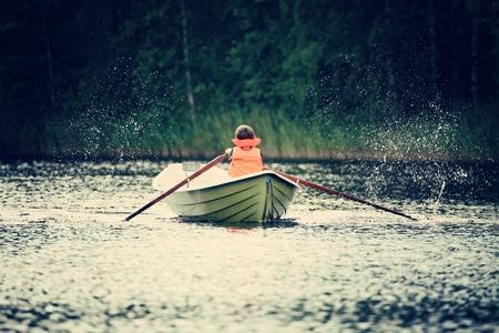 oar: a boy oar a boat