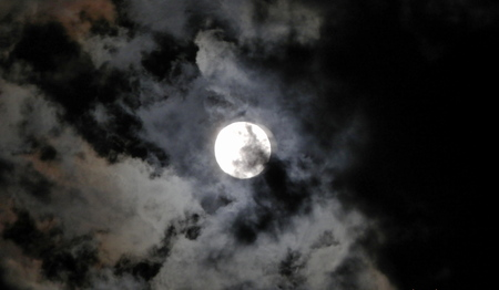 moon shining through clouds Stock Photo
