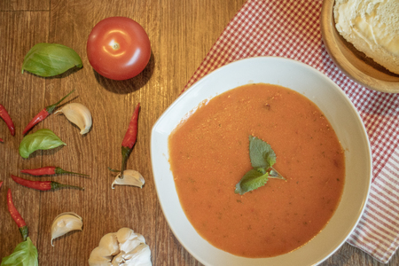 spicey: Mexican tomato soup with bread on the side Stock Photo
