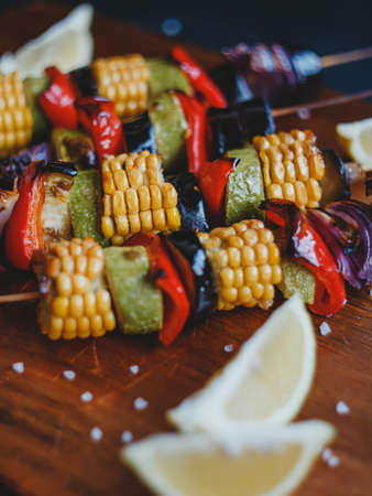 Skewers of grilled vegetables, corn, zucchini, eggplant, champignons, red pepper and onions.