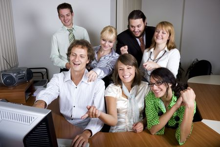 Young people laughing and pointing at the computer screen Stock Photo