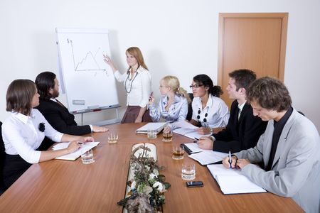 Team of young business people in conference room