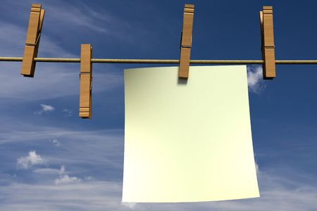 Blank piece of paper hanging on a clothesline photo