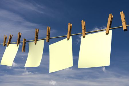 Four blank pieces of paper hanging on a clothesline photo