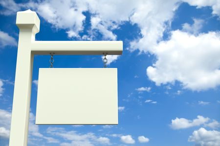 White blank board in front of a cloudy sky