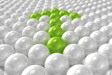 White 3D balls with green ones forming an arrow photo