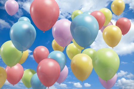 Lots of colorful balloons flying in the air photo