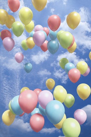 Colorful balloons flying in the air photo