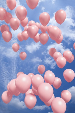 Red balloons flying in the air photo
