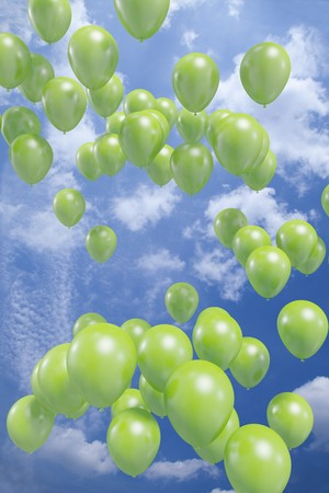 Green balloons flying in the air