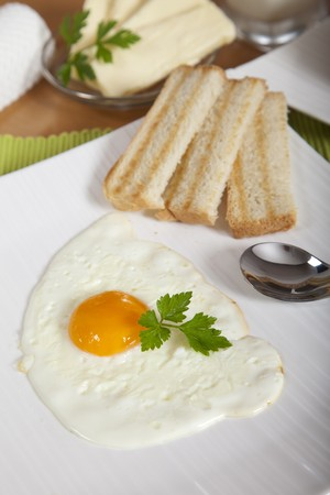 Delicious sunny side egg with roasted toast for breakfast Stock Photo