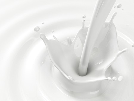 Pouring milk splash with copyspace photo