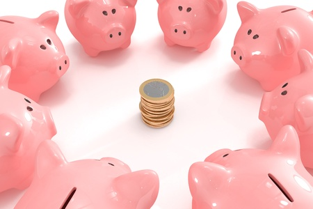 Group of piggy banks looking at a pile of coins Stock Photo