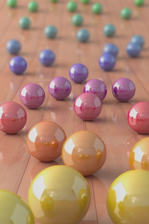 Colorful marble balls on a parquet floor photo