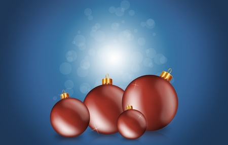 Red christmas baubles on a blue background with copyspace photo