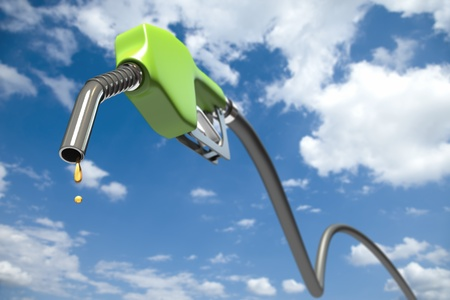 fuel economy: Fuel dripping out of a green fuel nozzle