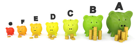 Energy scale made out of piggy banks and coins Stock Photo